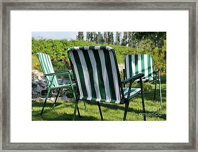 Empty Seats On Garden Lawn Framed Print by Sami Sarkis
