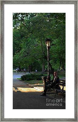 Enjoying The Moment In Central Park Framed Print by Lee Dos Santos