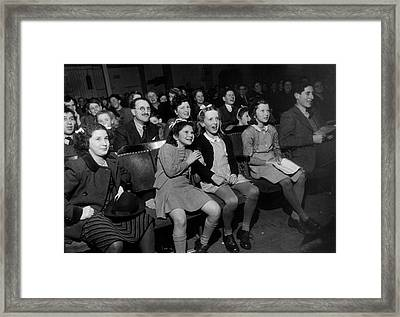 Enthralled Audience Framed Print by Kurt Hutton