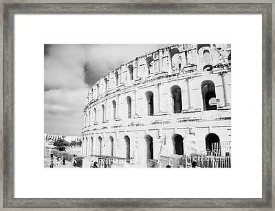 Entrance And Front Of The The Old Roman Colloseum Against Blue Cloudy Sky El Jem Tunisia Framed Print by Joe Fox