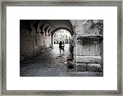 Entry Of The Cyclist Framed Print