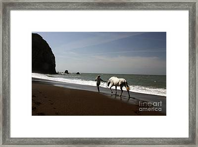 Equestrian Surf Framed Print by Juan Romagosa