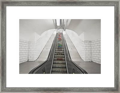 Escalator Down To An Underground Metro Framed Print by Marlene Ford