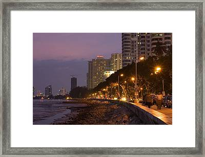 Evening Falls Over Water Front Buildings Framed Print by Austin Bush