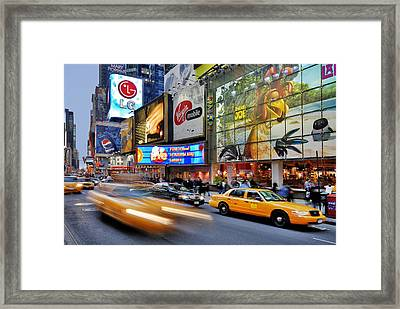 Evening Traffic At Times Square Framed Print by Izzet Keribar