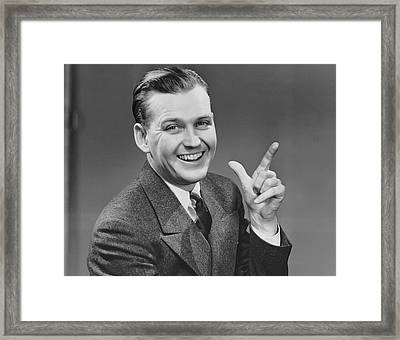Executive Smiling And Gesturing Framed Print by George Marks