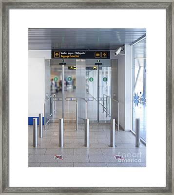 Exit To A Baggage Claim Framed Print