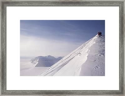 Expedition Skiers Climb Nemtinov Peak Framed Print by Gordon Wiltsie