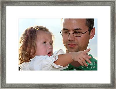 Explaining It All To Dad Framed Print by Susan Stevenson