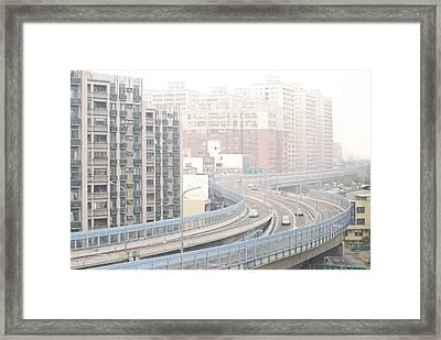 Expressway Through City Framed Print by Lawren