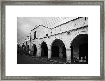 exterior of buyuk han the great inn in nicosia TRNC turkish republic of northern cyprus Framed Print by Joe Fox