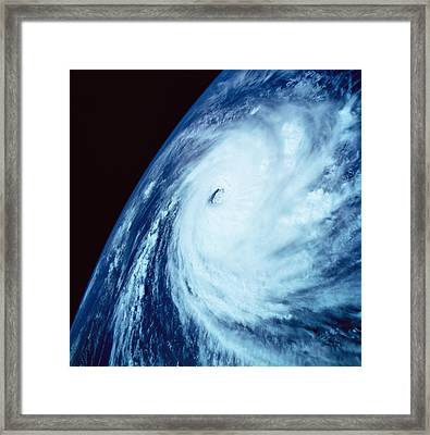 Eye Of A Storm Over Earth Viewed From Space Framed Print by Stockbyte