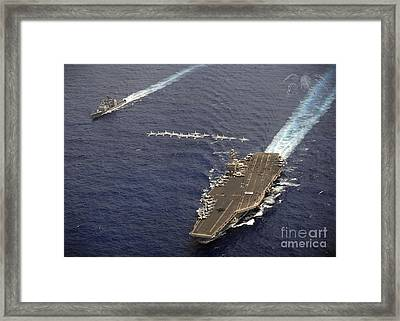 Fa-18 Hornets Fly In Formation Over Uss Framed Print