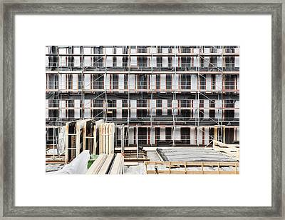 Facade Of Buildings Under Construction Framed Print by Corepics