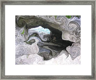 Faces In The Grotto Framed Print