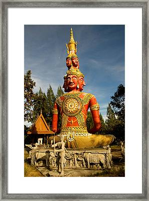Faces Of Buddha Framed Print by Adrian Evans