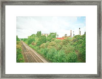 Factory And Trainlines Framed Print by Tom Gowanlock