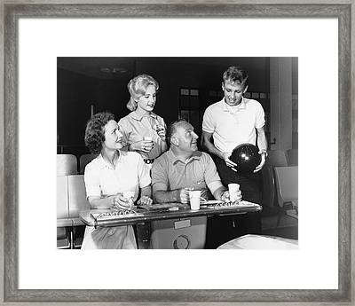 Family At Bowling Alley Framed Print by Stockbyte