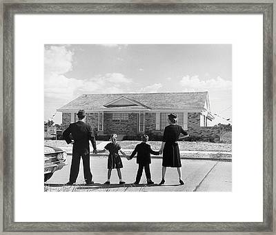 Family Holding Hands, Looking At A House For Sale (1950) Framed Print by Archive Holdings Inc.