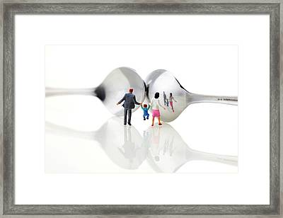 Family In Front Of Spoon Distoring Mirrors II Framed Print by Paul Ge