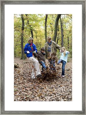 Family Playing In A Wood Framed Print