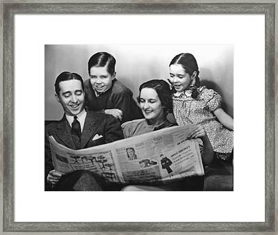 Family Reading Newspaper Framed Print by George Marks
