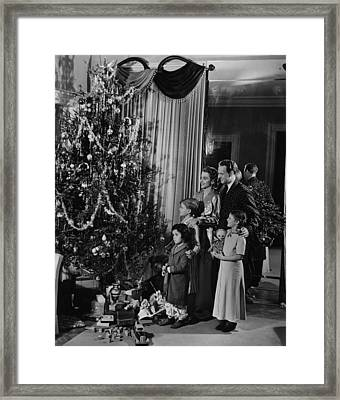 Family With Three Children (4-9) Standing At Christmas Tree, (b&w) Framed Print by George Marks