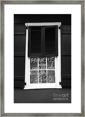 Famous New Orleans Po Boys Red Neon Window Sign Black And White Framed Print by Shawn O'Brien