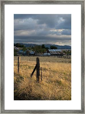 Farmland Fence Post Framed Print by Peter Tellone