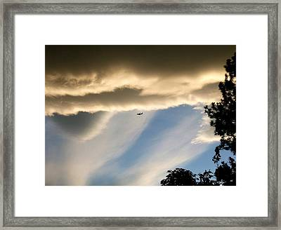 Fascinating Clouds And A 737 Framed Print