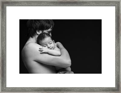 Father Holding His Newborn Baby Framed Print by Pavlo Kolotenko