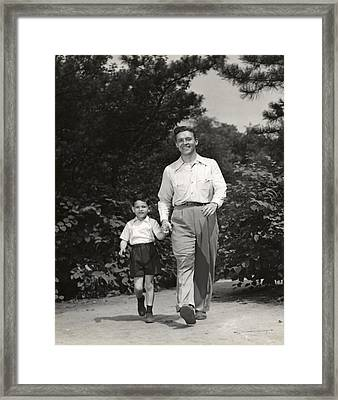 Father Walking With Son Framed Print by George Marks