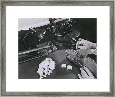 Fbi Forensic Science. A Technician Framed Print by Everett