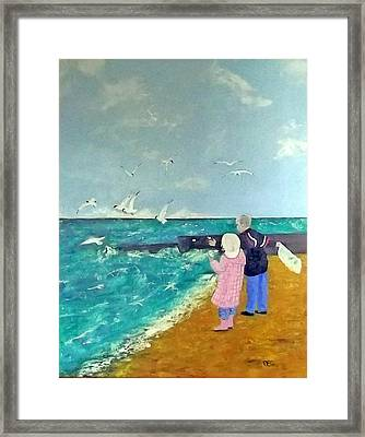 Feeding The Gulls Framed Print by Peter Edward Green
