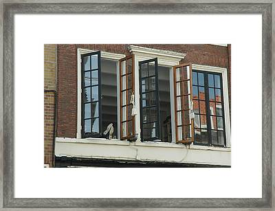 Feet Out The Window Framed Print by Lee Versluis
