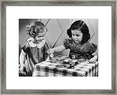 Female Siblings Having A Tea Party Framed Print by George Marks