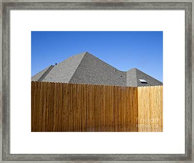 Fence And Roof Framed Print by David Buffington