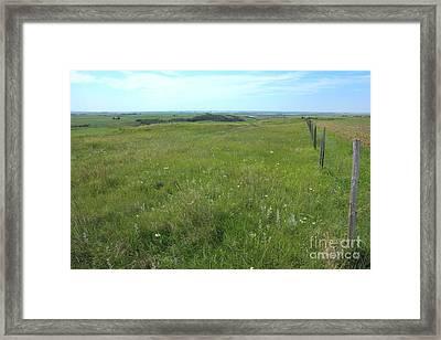 Fence On The Alberta Prairie Framed Print by Jim Sauchyn