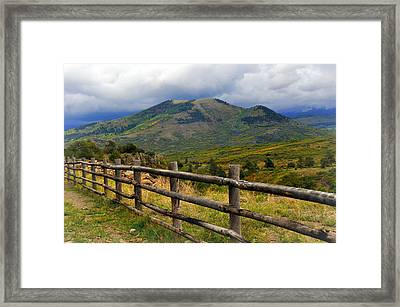 Fence Row And Mountains Framed Print by Marty Koch