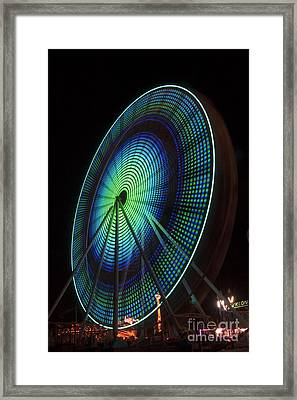 Ferris Wheel Lit Shades Of Green And Blue Framed Print