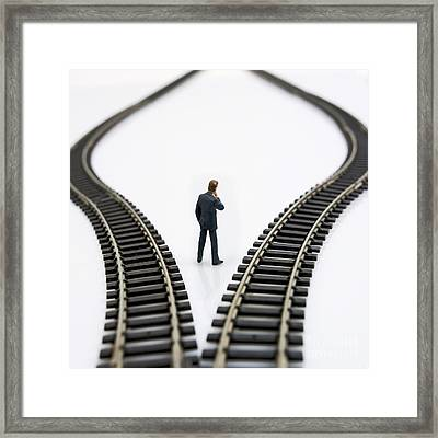 Figurine Between Two Tracks Leading Into Different Directions  Symbolic Image For Making Decisions Framed Print
