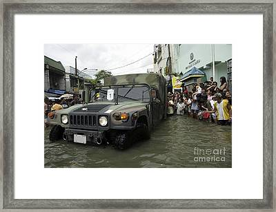 Filipino Citizens Stand In Line Framed Print by Stocktrek Images