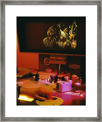 Film Editing Framed Print by Carlos Dominguez