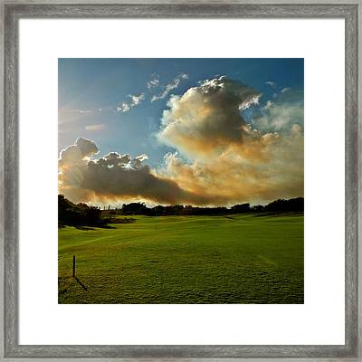 Fire Clouds Over A Golf Course Framed Print