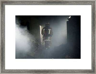 Fire Fighter In A Burnt House Framed Print by Michael Donne
