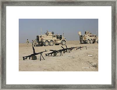 Firearms Sit Ready On A Firing Range Framed Print by Terry Moore