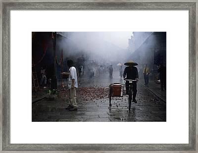 Firecrackers Litter Street Framed Print by Raymond Gehman