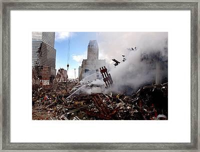 Firefighters Douse The Still Burning Framed Print by Everett