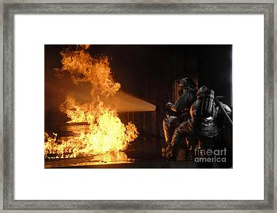 Firefighters Extinguish A Simulated Framed Print