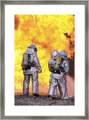 Firefighters Extinguish An Aircraft Framed Print